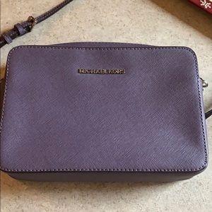 Purple Michael Kors crossbody purse